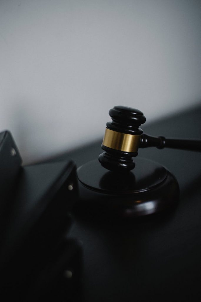 black gavel on table in courtroom